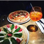 Pizzas and Aperol Spritz