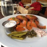 House cured salmon with potato pancakes, capers, cornichons and horseradish cream