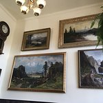 Beautiful landscape paintings cover the walls...