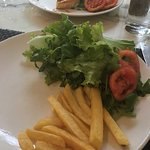 poorly plated side of fries...why give a guest 2 salads :(