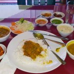 Fixed price lunch at 120,000 VND plus banana lassi, totaling 150,000 VND ($6.60 USD)