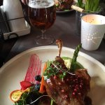 Duck confit main dish with a lovely glass of Latvian ale.