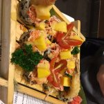Mango Crab Roll with fresh mango, cherry tomato, shredded crab