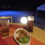 Great hangout by the beach, live music, good music requests, pleasant evenings, decent service.