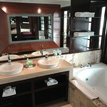 Vanities and indoor two-person jetted tub. Outdoor patio had a larger two-person jetted tub!