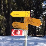 Hiking trail signs to the restaurant from Verbier