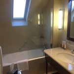 bathroom on top floor with slanted ceiling, no stand up shower stall