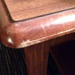 Table in room looked as marred and scratched up as lobby furniture.