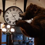 James the bear and antique clock