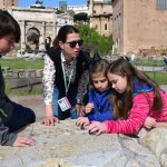 playing an ancient marble game at the Roman Forum Ruins