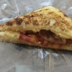 The grilled cheese with bacon and tomato. This was after eating 3 of the 4 pieces.