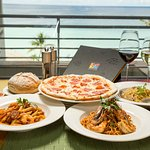 Enjoy a vibrant dinner at Prego with inspiring sunsets and ocean views.