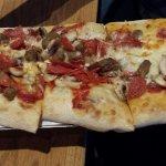 Mushroom, pepperoni, tomato and sausage flatbread pizza.
