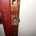 Broken door frame to our room