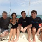 The Hokanson family poses for a photo onboard the Stiletto catamaran operated by VientosTulum.
