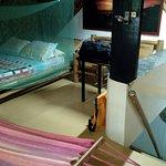 Upstairs bedroom with bed, hammock, & bamboo furnishings