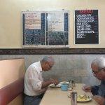 Customers busy in enjoying Goan dishes