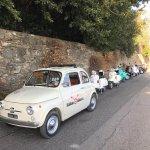 Vintage Fiat pace car with Vintage Vespas