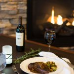 Enjoy a fireside table with your favorite dinner pairing.