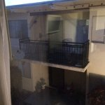 apartment building patios back up to hotel rooms