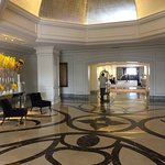 The lobby, with gold and silver leaf touches everywhere. Fresh flowers throughout.