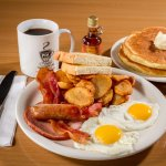 "The BIG Breakfast- two eggs, bacon, ham, sausage, home fried potatoes, toast & ""Heavenly Hot Cak"