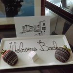 A card & strawberries to welcome us back, wonderful touch