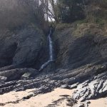 One of the beautiful natural waterfalls from the streams locally that flow into the beach