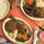 Whole grilled snapper and BBQ ribs served with traditional rice & peas. Fish is a must-try!