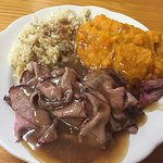 Roast beef Luncheon portion with squash, gravy and rice