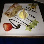Apple strudel with vanilla ice cream, chocolate syrup and star fruit!