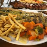 Full rack with lemon pepper seasoning, fries and vegetable side.