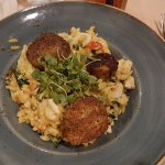 Grilled scallops over creamy orzo.