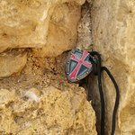 Crusader Challenge coin place in a wall that was built by the Crusaders
