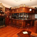 House guests can enjoy a drink in this gorgeous bar - and listen to some of the stories .