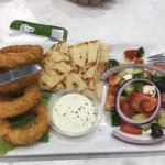 Calamari with dipping bread and Greek salad, kids nuggets and chips