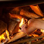 Keep snug whatever the weather in our bar with wood-burning fireplace