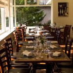 Our light and spacious restaurant has great views of our garden