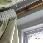 Curtain not attached to rail , runners missing, second window was the same.