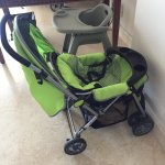 stroller and high chair in room