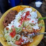 Pulled pork enchiladas with refried beans and Mexican rice