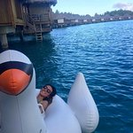 Lounging outside our bungalow with the swan float