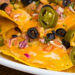 House-made Tortilla Chips smothered in Cheese with jalapenos, olives, Salsa, add Chili as an opt