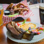 Famous Smoked Wings and Beef Short Rib with Mac and Cheese and Salad. Add a Guiness or Sam Adams