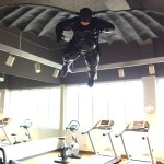 gym with Batman exercise instructor