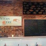 Hank's Oyster Bar menu board