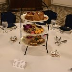 Half-round tables of 8 set for afternoon tea and keynote address.