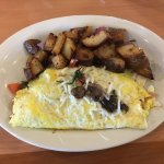 Florentine turkey omelet with country potatoes
