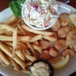 Seafood Platter with scallops, homemade coleslaw and french fries.