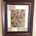 Framed picture of coins from around the world in Travelers Suite